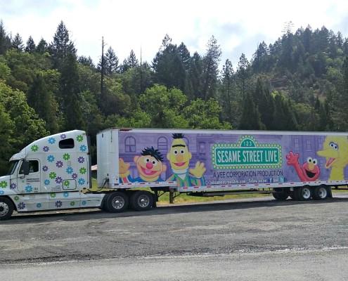 Powersource truck hauling Sesame Street Live trailer
