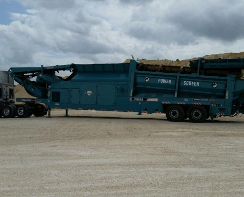 Powersource truck hauling Power Screen Crusher