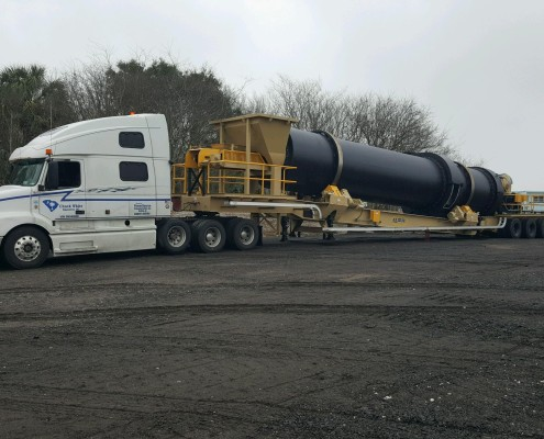 Powersource driver owner-operator Chuck White's truck hauling oversize industrial load
