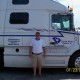 Powersource driver owner-operator Chuck White standing in front of his truck