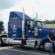 Powersource driver, owner-operator Todd Kennedy standing in front of his blue truck