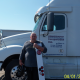 Powersource driver, owner-operator Gary Petrie standing in front of his truck