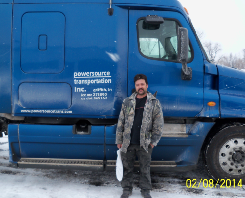 Powersource driver owner-operator Leonid Sobolev standing in front of his truck