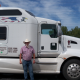 Powersource driver owner-operator Patrick Paul standing in front of his truck