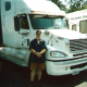 Powersource driver owner-operator Mike Beck standing in front of his truck