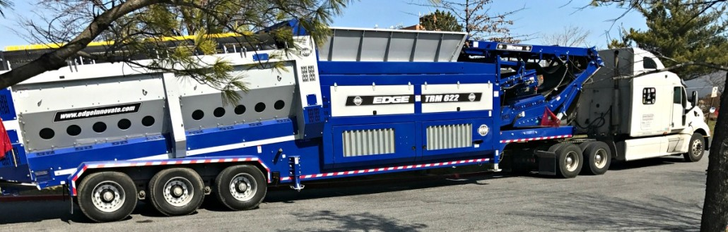 Powersource truck hauling Edge Innovate track conveyor trailer