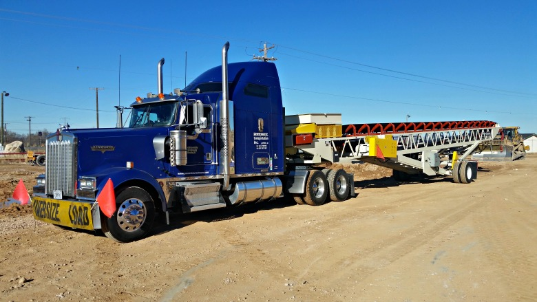 Powersource truck hauling oversize load, industrial