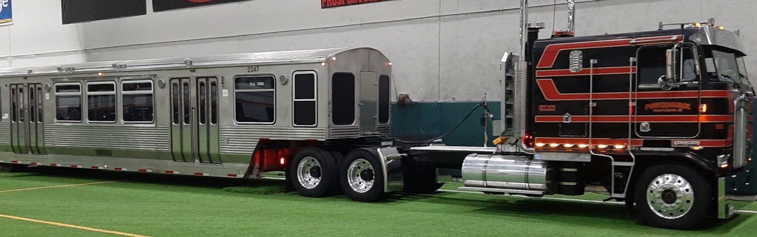 Black, Red, and Gold Cab and RR Trailer