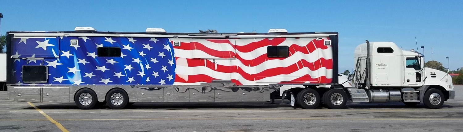 White Cab with Flag Wrapped Military Trailer
