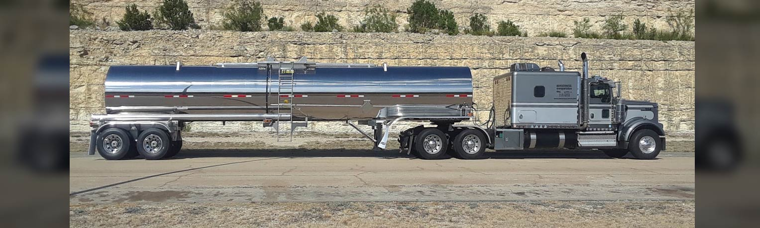 Dark Gray Cab and Chrome Tank Trailer in Mountain Cut