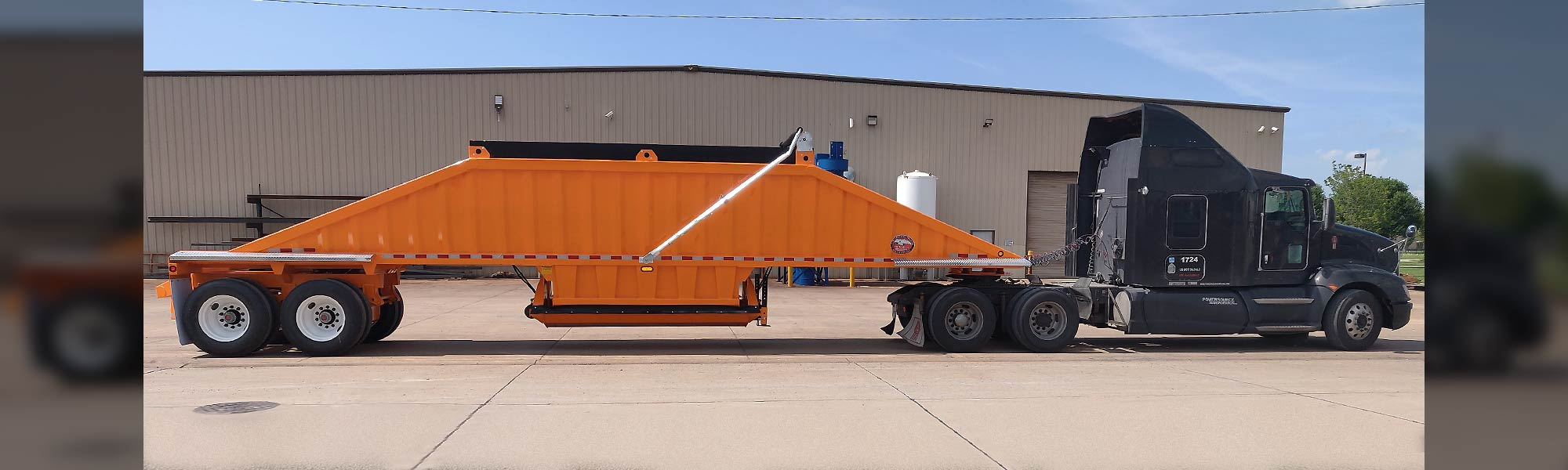 Dark Cab with Orange Bulk Trailer