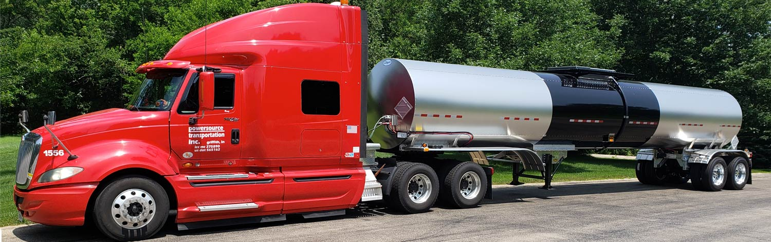 Red Cab with Silver and Black Tank Trailer