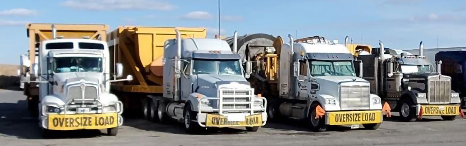 Line of Over-Dimensional Tractor Trailers