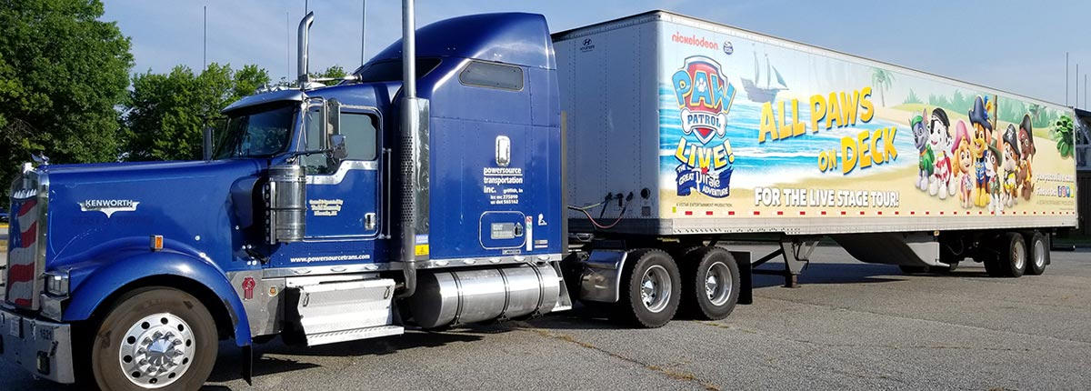 Blue Semi Tractor with All Paws on Deck Trailer