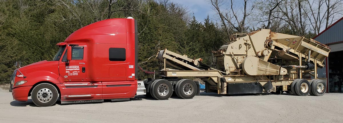 Red Cab with Tan Machinery Trailer